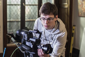 Student mit Kamera