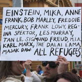 Sign listing some notable refugees - Refugee Action protest 27 July 2013 Melbourne