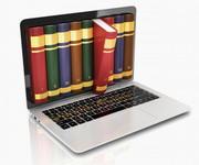 Laptop mit Bücherreihe auf dem Bildschirm,